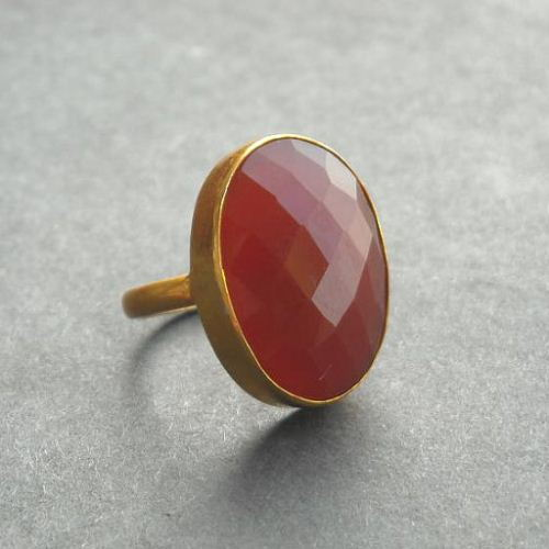 Faceted oval red carnelian gold
