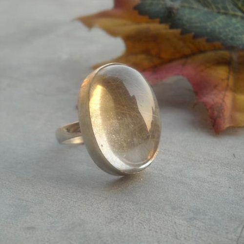 Golden rutile white quartz ring